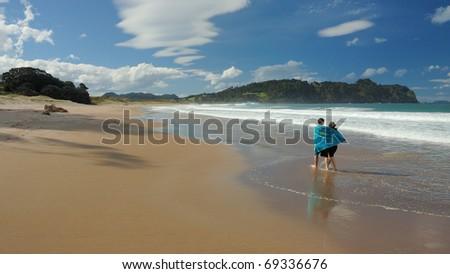 Walk on hot water beach - Hahei - New Zealand - stock photo