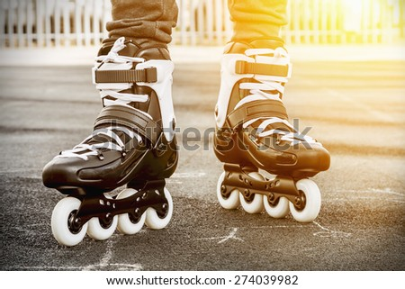 walk on roller skates for skating. Focus on roller skates. - stock photo