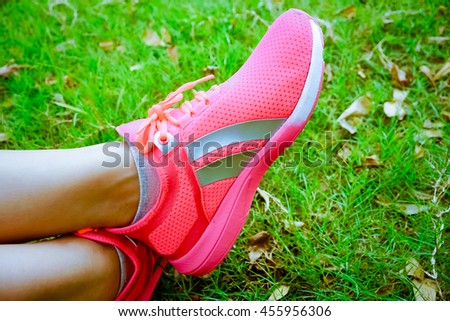 Walking and jogging woman with athletic legs and running shoes. - stock photo