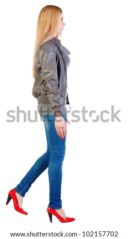 walking blonde girl in motion.  back view of going woman.  during a walk. Rear view people collection.  backside view of person.  Isolated over white background. - stock photo