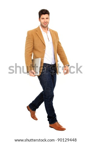 walking business man holds a laptop - stock photo