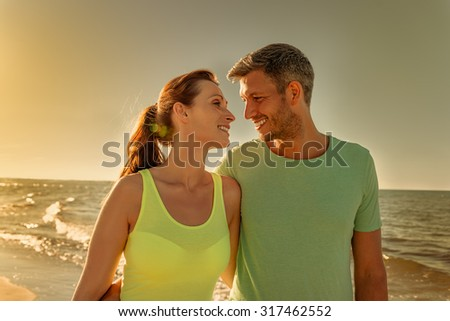 walking couple after fitness run - stock photo