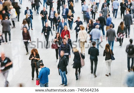walking crowd of people at a fair floor