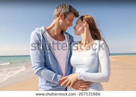 walking down seaside avenue looking eachother - stock photo