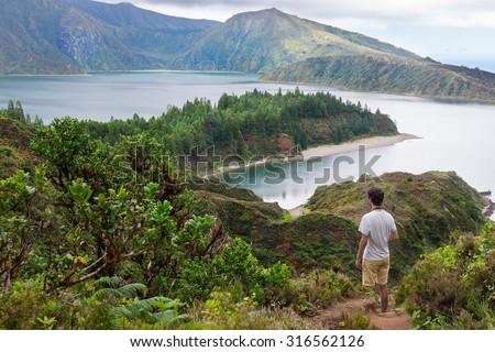 Walking down to Lagoa do Fogo in Sao Miguel, Azores Islands - stock photo