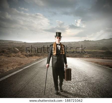walking elegant man - stock photo