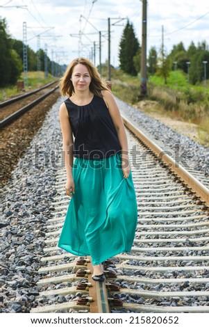 Walking girl on the railway - stock photo