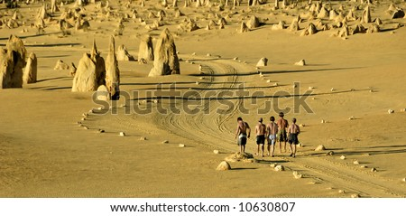 Walking in the Pinnacles desert in Western Australia - stock photo