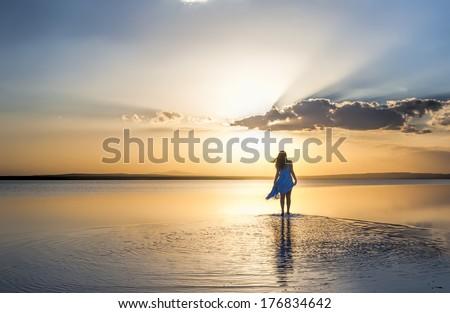 Walking into sunset - stock photo