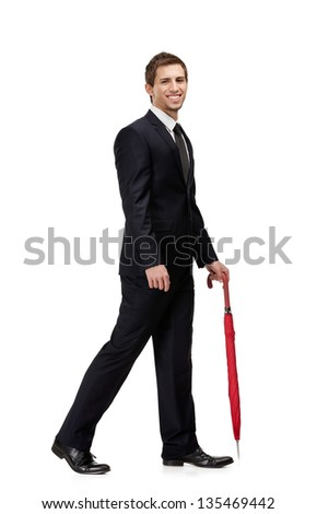 Walking man with closed red umbrella, isolated on white - stock photo