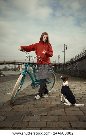 Walking of dog with retro bicycle - stock photo