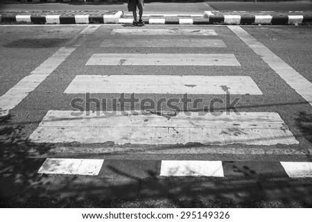walking on crosswalk - stock photo