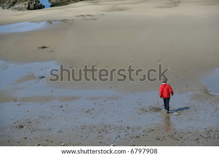 Walking on the beach at low tide, red parka,	Agate Beach, 	Newport, 	Oregon coast