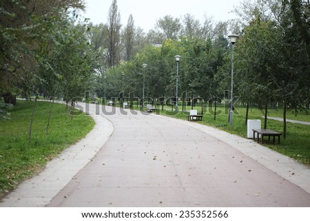 Walking Path in the Nature and trash can - stock photo