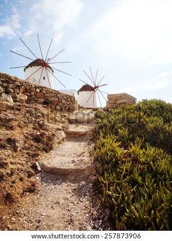 Walking path to Windmills of Mykonos, famous landmark. Greece. - stock photo
