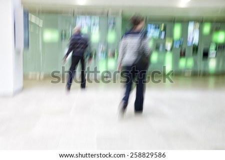 Walking people, motion blur, zoom effect - stock photo
