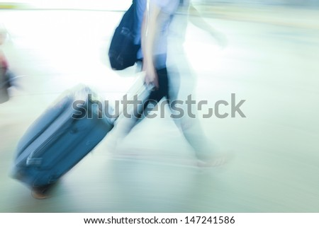 walking people with baggage background - stock photo