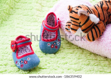 Walking shoes for baby. - stock photo