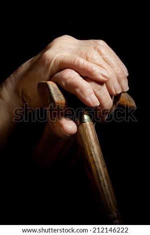 walking stick in hand of senior woman - stock photo