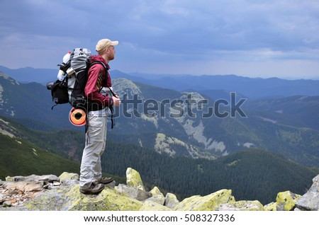 Walking tourists on a mountain top