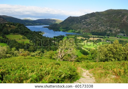 Walking towards Ullswater in summer in the English Lake District - stock photo