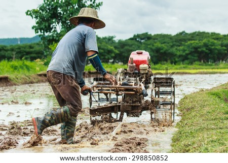 Walking tractor - Thailand rice planting season has started. - stock photo