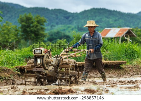 Walking tractor - Thailand rice planting season has started-Lampang province Thailand-country July 22 2015 - stock photo