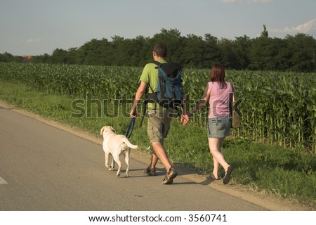 walking with the dog - stock photo