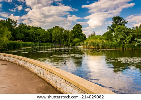 Walkway along a pond at Patterson Park, Baltimore, Maryland. - stock photo
