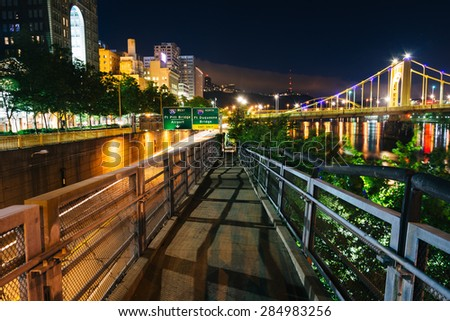 Walkway along the Allegheny River at night, in Pittsburgh, Pennsylvania. - stock photo