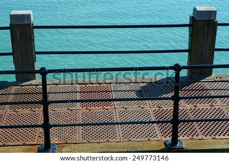 Walkway and railings on pier at Worthing, West Sussex, England - stock photo