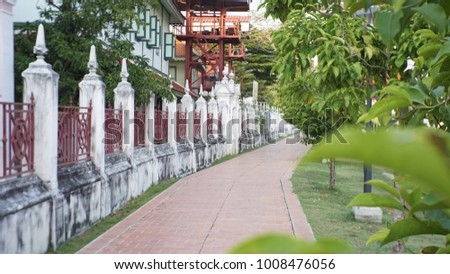 Walkway beside fence