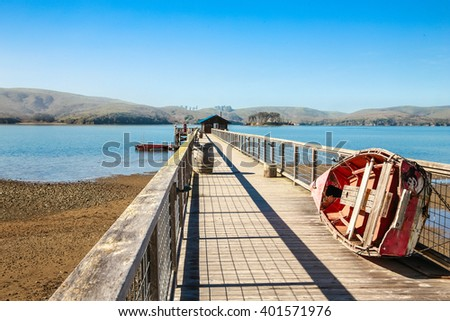 Walkway down the long dock on the bay, Point Reyes National Seashore, Marin County, California - stock photo