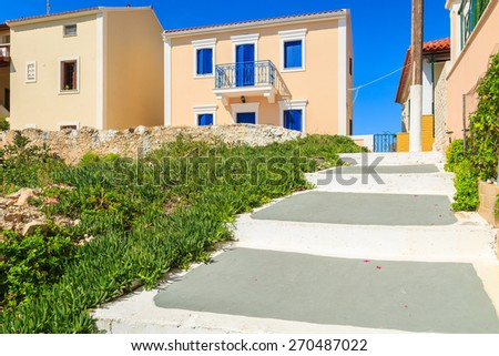 Walkway in Assos town with typical Greek houses built in Venetian style, Kefalonia island, Greece - stock photo