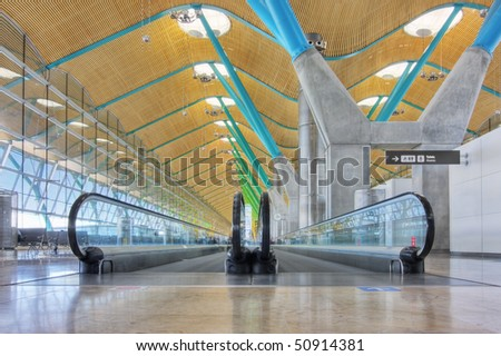 Walkway in departure hall - Airport Madrid Barajas - HDR image - stock photo