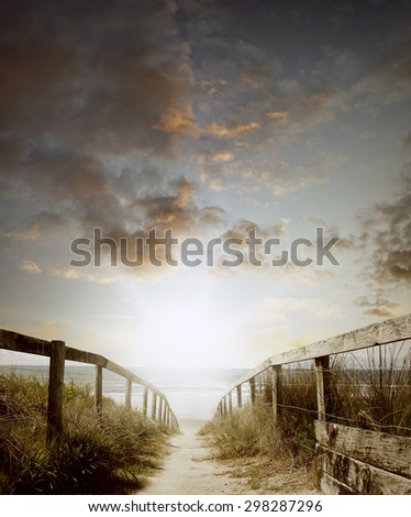 Walkway leading to beach scene - stock photo