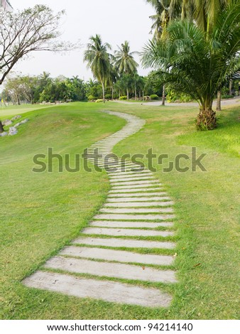 Walkway on green grassy in golf club
