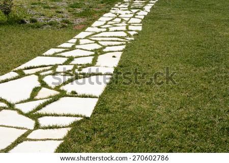 walkway stones/walkway stones in an elegant green lawn - stock photo