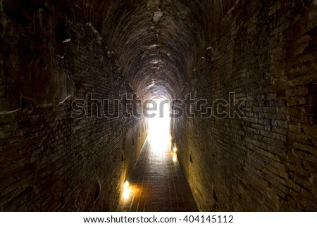 Walkway tunnel made by red brick and middle white isolated space for text or design - stock photo