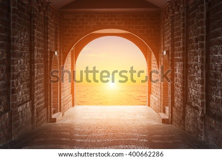 Walkway tunnel made by red brick and view of sunset or sunrise time