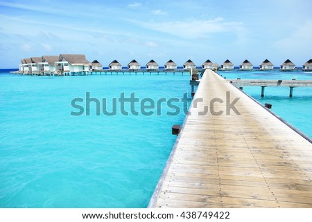 Walkways to the over water villas, Maldives island resort
