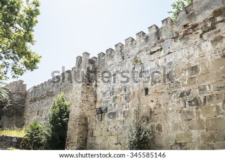 wall and tower of medieval castle in Marbella Andalucia Spain - stock photo