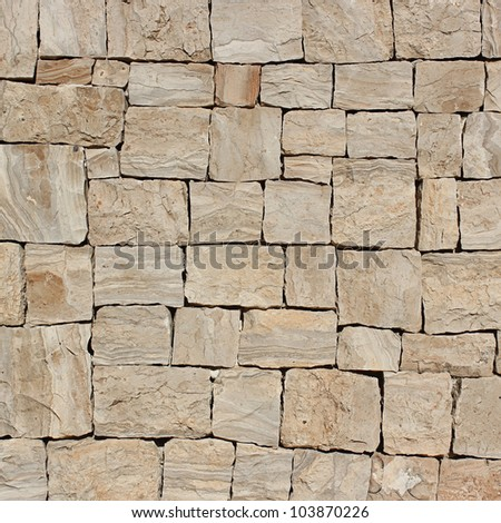 Wall beige stone structure. - stock photo