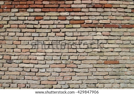 Wall built of burnt brick - stock photo