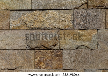 Wall built of natural stone. Can be used as background - stock photo