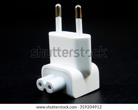 Wall charger in black background - stock photo