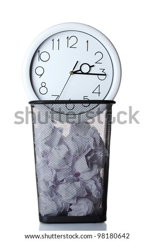 Wall Clock and paper in metal trash bin isolated on white - stock photo