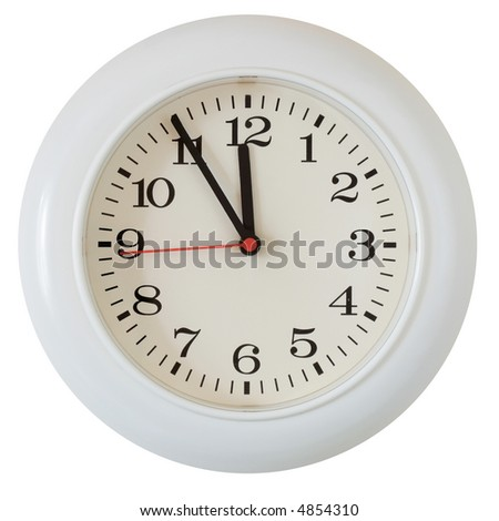 Wall clock dial close-up, five minutes to twelve - stock photo