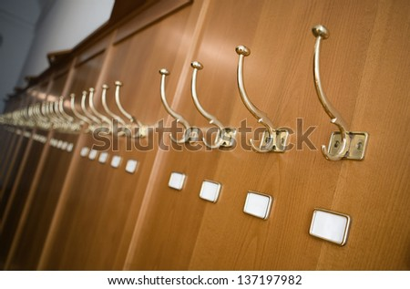 wall coat hangers with white name tags. suitable for your text. copyspace. - stock photo