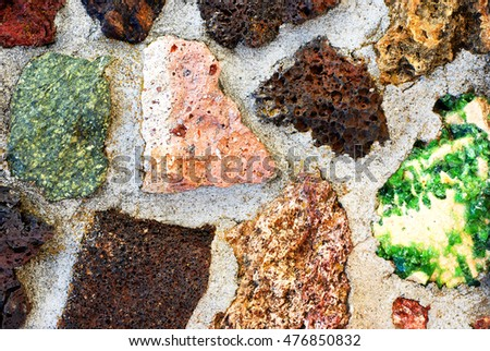 Wall constructed of various volcanic rocks, minerals, and crystals